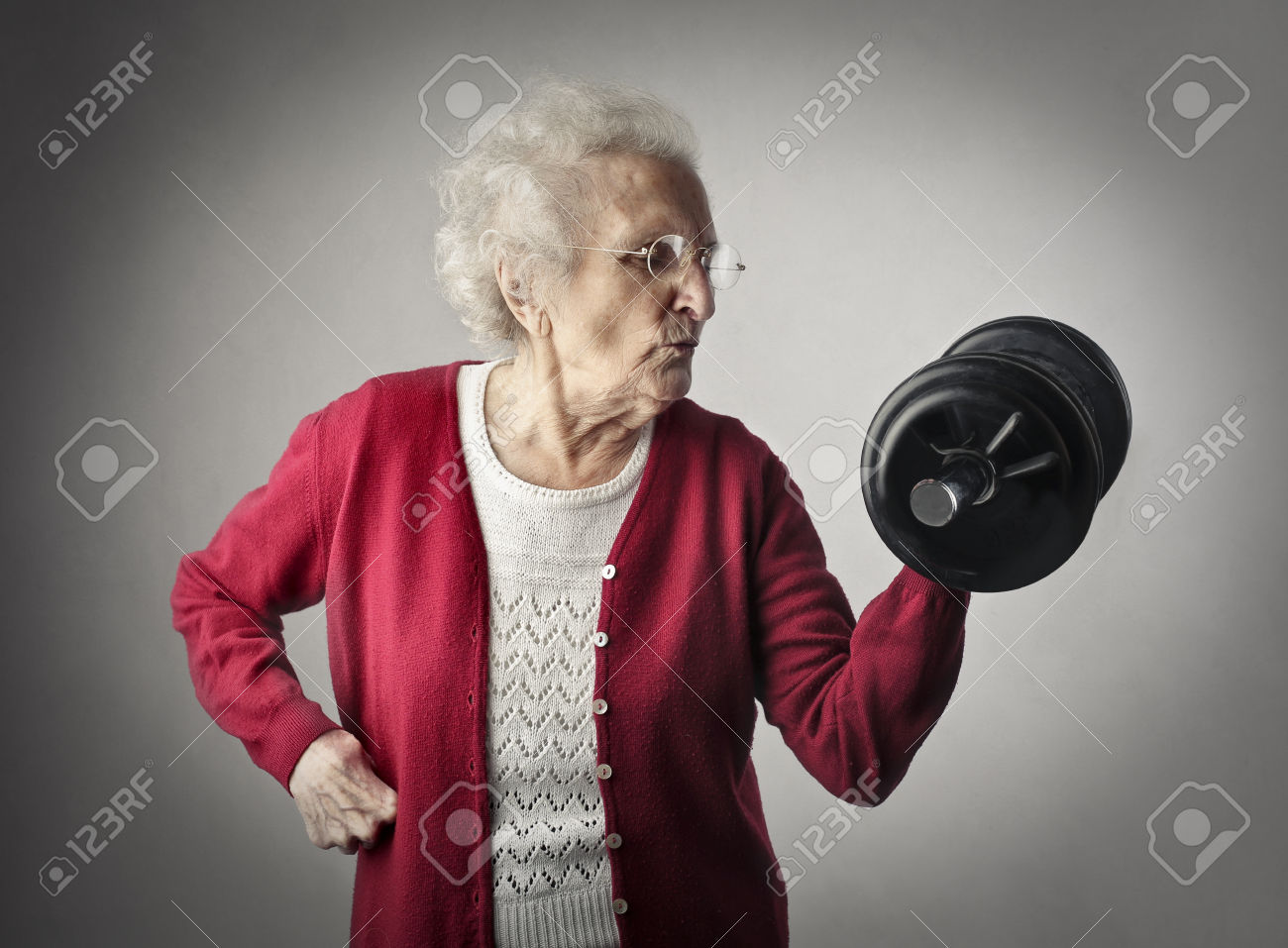 36234884-Elderly-woman-lifting-weights-Stock-Photo